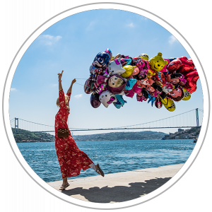 Woman with balloons by the Bosphorus in Istanbul