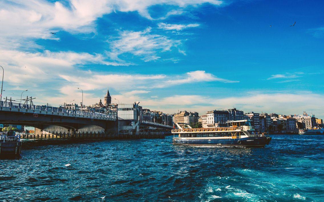 Boat crossing the Galata Bridge